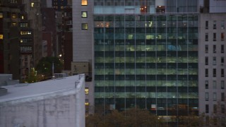 AX121_067 - 6K stock footage aerial video of Midtown city canyons at twilight in New York City