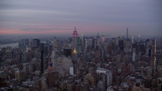 AX121_079 - 6K stock footage aerial video Midtown high-rises and the Empire State Building at twilight in New York City