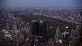 AX121_091 - 6K stock footage aerial video approach Time Warner Center and Central Park at twilight in New York City