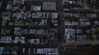AX121_095 - 6K stock footage aerial video of a bird's eye of row houses and streets on the Upper West Side at twilight, New York City