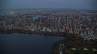 AX121_096 - 6K stock footage aerial video orbit Upper East Side skyscrapers near Central Park at twilight in New York City