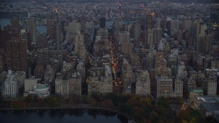 AX121_097 - 6K stock footage aerial video approach Upper East Side apartment buildings at twilight in New York City