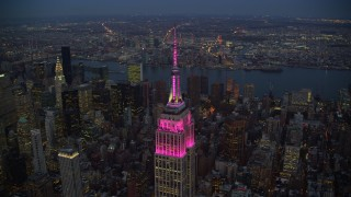 AX121_108 - 6K stock footage aerial video orbit top of Empire State Building at twilight in Midtown, New York City