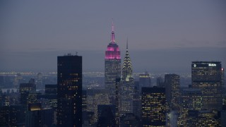 AX121_120 - 6K stock footage aerial video of the Empire State Building and Chrysler Building at twilight in Midtown Manhattan, New York City