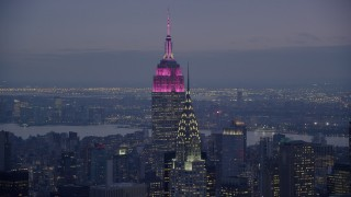 AX121_123 - 6K stock footage aerial video of top of Chrysler Building and Empire State Building at twilight in Midtown, New York City
