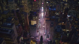 AX121_135 - 6K stock footage aerial video approach Times Square at Night in New York City