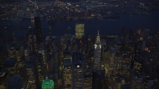 AX121_137 - 6K stock footage aerial video approach Chrysler Building at Night in New York City