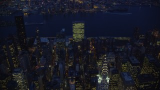 AX121_137E - 5.5K stock footage aerial video approach Chrysler Building at Night in New York City