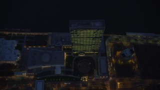 AX121_140 - 6K stock footage aerial video of a bird's eye of United Nations at Night in Midtown, New York City