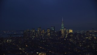 AX121_153 - 6K stock footage aerial video approach Lower Manhattan skyline at Night in New York City