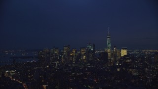 AX121_154 - 6K stock footage aerial video of the skyline of Lower Manhattan at Night, New York City