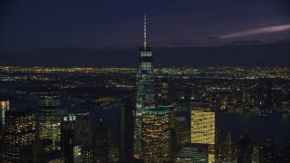 AX121_160 - 6K stock footage aerial video orbit One World Trade Center in Lower Manhattan, New York City at Night
