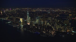 AX121_171E - 5.5K stock footage aerial video approach Lower Manhattan at Night, New York City