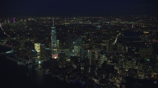 AX121_173 - 6K stock footage aerial video approach Freedom Tower and Lower Manhattan, New York City at Night