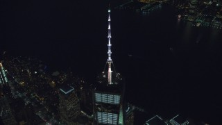 AX121_180 - 6K stock footage aerial video approach top spire of Freedom Tower at Night in Lower Manhattan, New York City