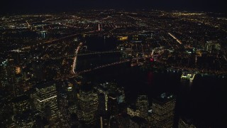 AX121_184 - 6K stock footage aerial video orbit Brooklyn and Manhattan Bridges at Night in New York City