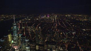 AX121_185E - 5.5K stock footage aerial video of Midtown seen from Freedom Tower at Night in New York City