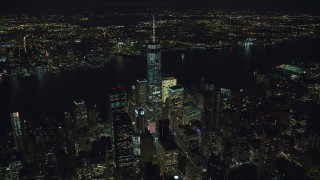 AX121_188 - 6K stock footage aerial video orbiting World Trade Center Skyscrapers at Night in Lower Manhattan, New York City