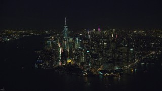 AX121_193 - 6K stock footage aerial video orbit the tip of Lower Manhattan at Night in New York City