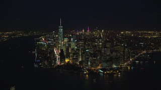 AX121_193E - 5.5K stock footage aerial video orbit the tip of Lower Manhattan at Night in New York City