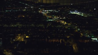 AX121_200 - 6K stock footage aerial video of a suburban neighborhood at Night in Jersey City, New Jersey