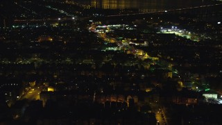 AX121_200E - 5.5K stock footage aerial video of a suburban neighborhood at Night in Jersey City, New Jersey