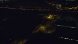 AX122_006 - 6K stock footage aerial video of flying over suburbs and reveal freeway with traffic at Night in Jersey City, New Jersey