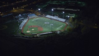 AX122_008 - 6K stock footage aerial video orbit multi-purpose stadium at Night in Jersey City, New Jersey