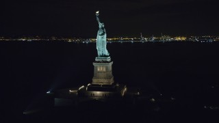AX122_016 - 6K stock footage aerial video of orbiting side of Statue of Liberty at Night in New York