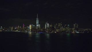 AX122_024 - 6K stock footage aerial video of the Lower Manhattan skyline at Night, New York City