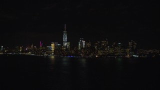AX122_024E - 5.5K stock footage aerial video of the Lower Manhattan skyline at Night, New York City