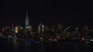 AX122_026E - 5.5K stock footage aerial video of approaching Lower Manhattan at Night in New York City