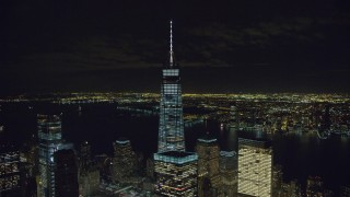 AX122_037 - 6K stock footage aerial video orbit around Freedom Tower at Night in Lower Manhattan, NYC