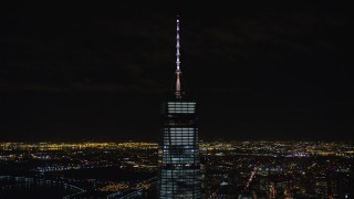 AX122_038 - 6K stock footage aerial video orbit spire of One World Trade Center at Night in Lower Manhattan, NYC