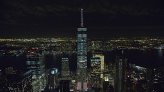 AX122_039 - 6K stock footage aerial video of a wide orbit of Freedom Tower at Night in Lower Manhattan, New York City