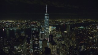 AX122_040 - 6K stock footage aerial video fly away from Freedom Tower at Night in Lower Manhattan, New York City