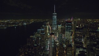 AX122_044 - 6K stock footage aerial video of Freedom Tower and World Trade Center skyscrapers, Lower Manhattan at Night in NYC
