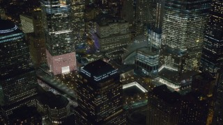 AX122_045 - 6K stock footage aerial video orbit World Trade Center Memorial, Lower Manhattan at Night in New York City