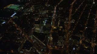 AX122_049 - 6K stock footage aerial video orbit Soho office buildings at Night in Lower Manhattan, New York City