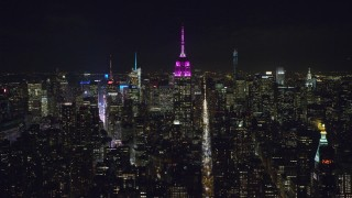 AX122_053 - 6K stock footage aerial video orbiting Empire State Building at Night in Midtown Manhattan, NYC