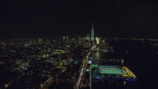 AX122_056 - 6K stock footage aerial video of heavy traffic on West Street to Lower Manhattan at Night in NYC