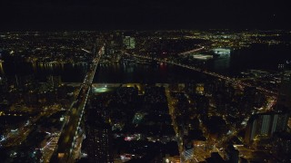 AX122_064 - 6K stock footage aerial video of an approach Brooklyn and Manhattan Bridge at Night in NYC