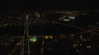 AX122_064E - 5.5K stock footage aerial video of an approach Brooklyn and Manhattan Bridge at Night in NYC