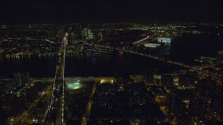 AX122_065 - 6K stock footage aerial video orbit Brooklyn and Manhattan Bridges over East River at Night, NYC