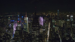 AX122_084 - 6K stock footage aerial video orbit the Empire State Building with unlit rooftop at Night in Midtown, NYC