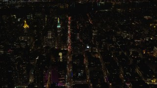 AX122_103 - 6K stock footage aerial video orbit city streets and high-rises at Night in Gramercy, New York City