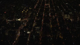 AX122_104 - 6K stock footage aerial video orbit hospital and city streets in Gramercy at Night in NYC