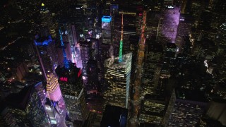 AX122_121 - 6K stock footage aerial video orbit the Bank of America Tower and Times Square at Night in Midtown, NYC
