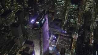 AX122_123 - 6K stock footage aerial video of orbiting Rockefeller Center and the ice skating rink in Midtown at Night, New York City