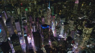 AX122_125 - 6K stock footage aerial video orbit skyscrapers around Times Square at Night in Midtown Manhattan, New York City